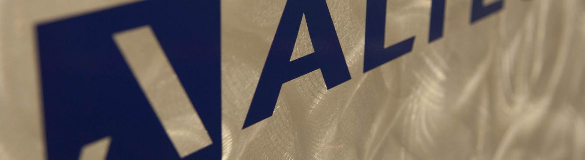 Altec Integrated Solutions logo on distressed metal background